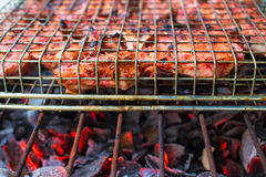 Grilled pork ribs on fireplace closeup photo. Red meat barbecue cooking. Stock Photography