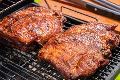 Grilled pork ribs on the grill barbecue. Grilled pork ribs on the flame grill barbecue Royalty Free Stock Photo