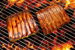 Grilled pork ribs. On the flaming grill Stock Image