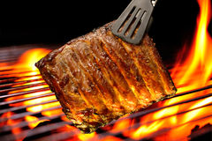 Grilled pork ribs. On the flaming grill Stock Photo