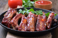 Grilled pork ribs in frying pan Stock Photos