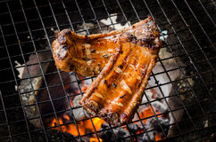 Grilled pork ribs. On the grill Royalty Free Stock Photography