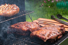 Grilled pork ribs on the grill. Royalty Free Stock Photo