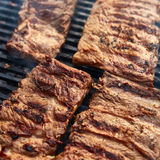 Grilled pork ribs on the grill Royalty Free Stock Photos