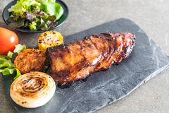 Grilled pork ribs. With barbrcue sauce and vegetable Stock Photography