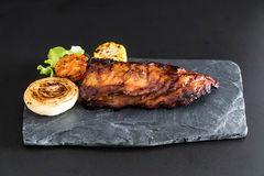 Grilled pork ribs. With barbrcue sauce and vegetable Stock Photo