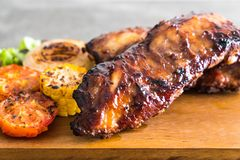 Grilled pork ribs. With barbrcue sauce and vegetable Royalty Free Stock Image