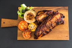 Grilled pork ribs. With barbrcue sauce and vegetable Royalty Free Stock Photography