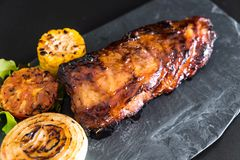 Grilled pork ribs. With barbrcue sauce and vegetable Stock Images