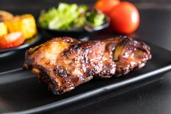 Grilled pork ribs. With barbrcue sauce and vegetable Stock Image