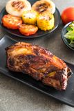 Grilled pork ribs. With barbrcue sauce and vegetable Royalty Free Stock Images