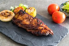 Grilled pork ribs. With barbrcue sauce and vegetable Royalty Free Stock Photo