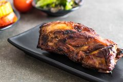 Grilled pork ribs. With barbrcue sauce and vegetable Royalty Free Stock Photos