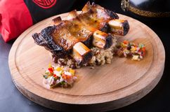 Grilled pork ribs. Served with rice on a wooden board Royalty Free Stock Photography