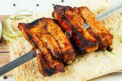 Grilled pork ribs. Skewer kebab Stock Image