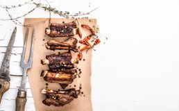 Grilled pork ribs with herbs top view Royalty Free Stock Photo