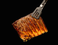 Grilled pork ribs. Isolated on black background Royalty Free Stock Photo