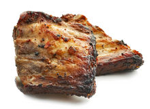 Grilled pork ribs. Isolated on white background Royalty Free Stock Photography