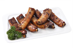 Grilled pork ribs on a plate isolated on white Royalty Free Stock Image