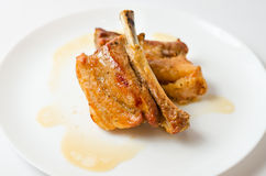 Grilled pork ribs in plate. Grilled pork ribs marinated in honey and soy Royalty Free Stock Image