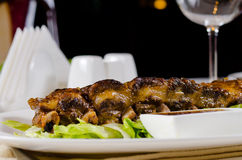 Grilled Pork Ribs on Plate in Restaurant Stock Photo