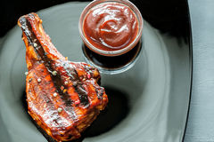 Grilled pork ribs on the plate Stock Photography