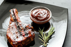 Grilled pork ribs on the plate Stock Image