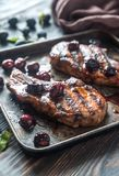 Grilled pork ribs in plum sauce. On the tray Stock Photography