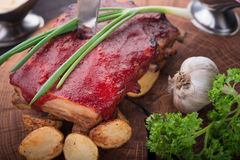 Grilled pork ribs with potato Stock Images