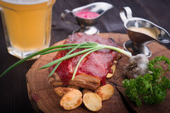 Grilled pork ribs with potato. On wood board Stock Photography
