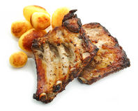 Grilled pork ribs and potatoes Stock Photos