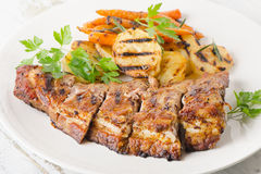 Grilled Pork Ribs and Potatoes on a Plate. Royalty Free Stock Photo
