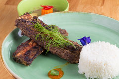 Grilled pork ribs and rice on plate. Stock Image