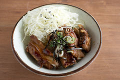Grilled pork ribs on rice with sliced cabbage. Closeup of Grilled pork ribs on rice with sliced cabbage and seaweed Royalty Free Stock Image