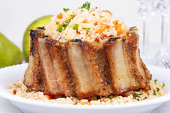 Grilled pork ribs with rice and spices Stock Image