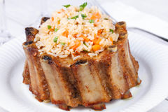Grilled pork ribs with rice and spices Royalty Free Stock Images