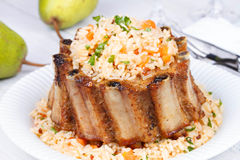 Grilled pork ribs with rice and spices Royalty Free Stock Image