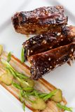 Grilled pork ribs with sauce.  Stock Images
