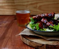Grilled pork ribs with sauce and beer Royalty Free Stock Image