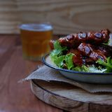 Grilled pork ribs with sauce and beer Stock Images
