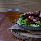 Grilled pork ribs with sauce and beer Stock Photos