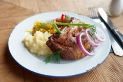 Grilled pork ribs with sauerkraut and mashed potatoes Stock Photo