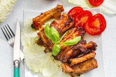 Grilled pork ribs served on a platter. Royalty Free Stock Image