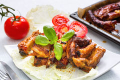 Grilled pork ribs served on a platter. Royalty Free Stock Photo