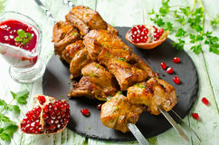 Grilled pork ribs on skewers. Barbecuing lunch. Homemade grilled pork ribs. Kebab on skewers and pomegranate sauce Stock Photo