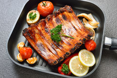 Grilled pork ribs. And vegetables on the grill pan Stock Image