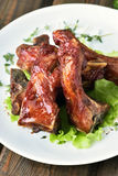 Grilled pork ribs on white plate Stock Photos
