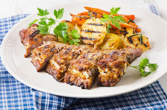 Grilled pork ribs  on a white plate. Royalty Free Stock Image