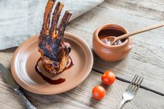 Grilled pork ribs on the wooden background Stock Image