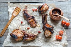 Grilled pork ribs on the wooden background Royalty Free Stock Photo